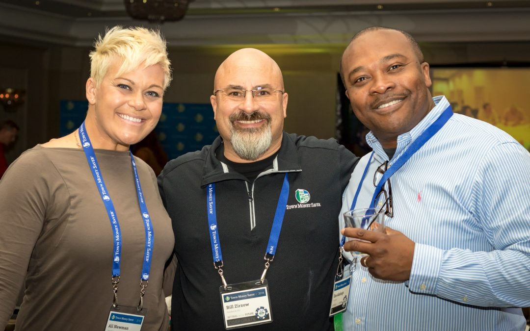 TMS President, center, Bill Zirzow poses with Eze Akabogu, right, and Ali Newman, left, during one of the company's annual meetings.