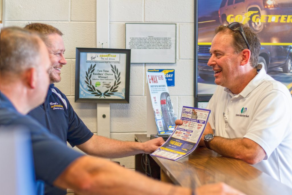 Town Money Saver franchisee working with a local business owner